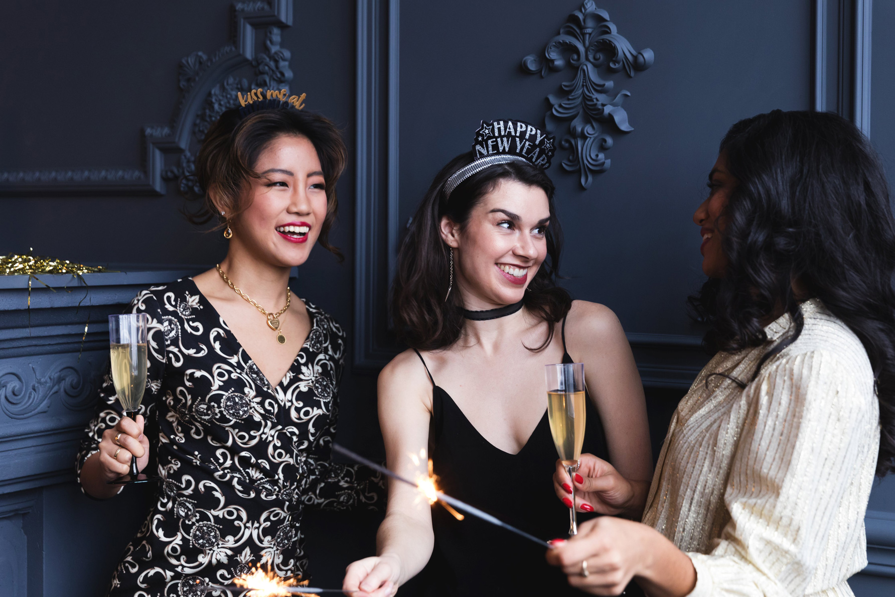 Three women at a party celebrating new year.